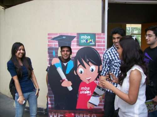 Students with the MBASkool standee